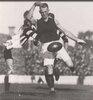 Ivor Warne Smith_ full kick hand in air.jpg